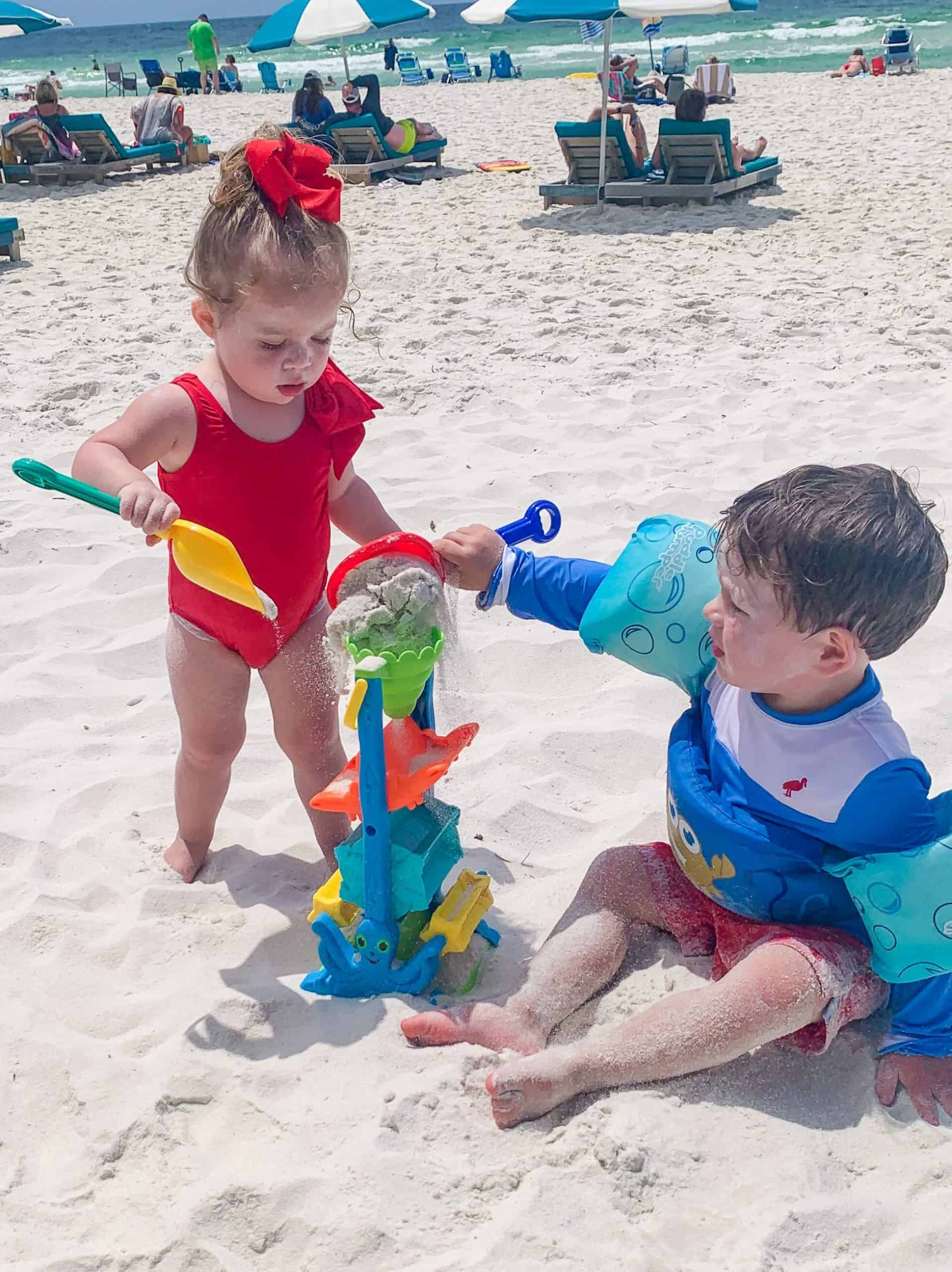 Hack #9: Bring on the Sand Toys- My motto is the more sand toys the better. We bring them all so if my kids get bored with one they can move on to another one. Our favorites are the ones made by Melissa and Doug, sandcastle molds, and this sand and water wheel.